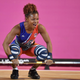woman with a barbell at a weightlifting competition