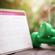calendar and dumbbells