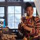 Journey (Madalen Mills) checks out her grandpa's workshop.