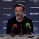 Screenshot from Ted Lasso: Ted speaking at a press conference