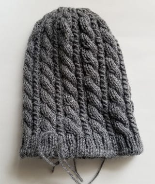 Finished hat, needs blocking and lining but the knitting's finished.