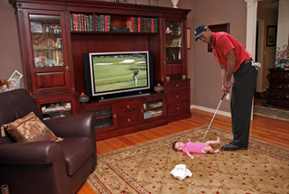 Tiger Woods Putts Baby Into Diaper