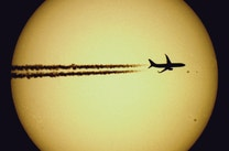 Perfectly Timed Pics of Aeroplanes Silhouetted Against the Sun and Moon