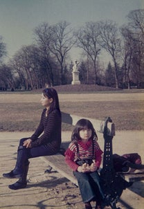 Time travelling photographer adds herself into her childhood pictures