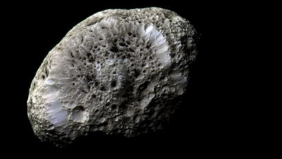 Saturn moon looks like a wasp nest and it may freak some people out
