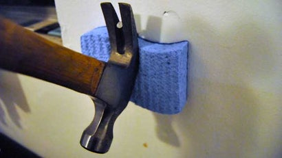 Protect Your Wall with a Sponge When Pulling Nails