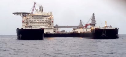 This is now Earth's largest ship — so big it can lift oil rigs off the sea