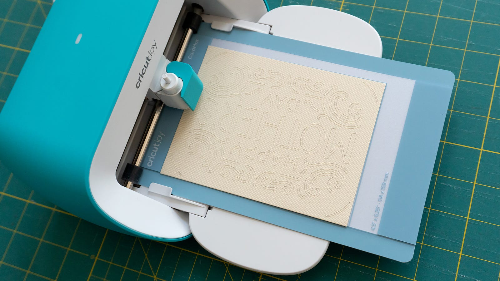 In lieu of a print head the Cricut Joy has a small moving mount that can hold either blades for cutting, or markers for drawing text and shapes.