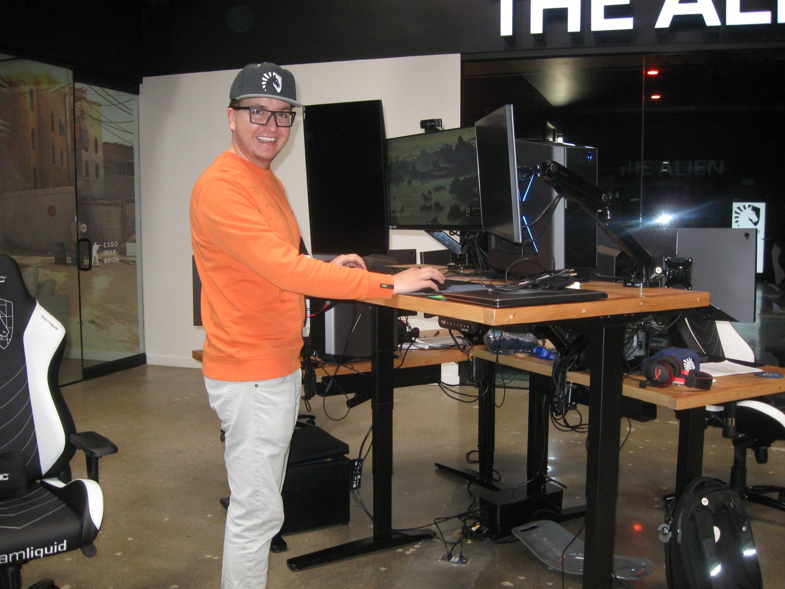 Team Liquid COO Mike Milanov shows off his own adjustable standing desk at the facility.