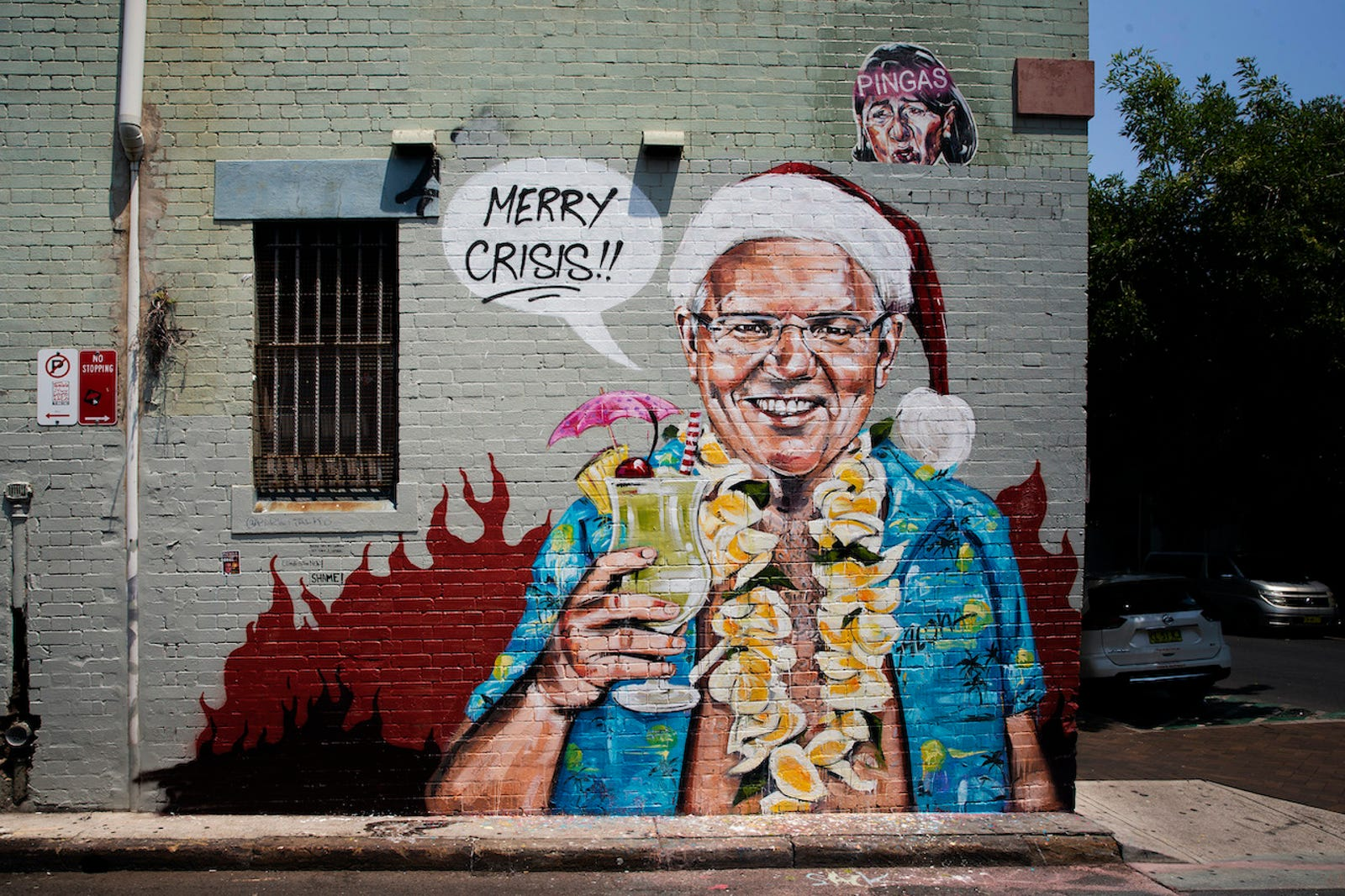 A mural by artist Scott Marsh depicting Prime Minister Scott Morrison on vacation in Hawaii is seen on December 26, 2019 in Sydney, Australia.