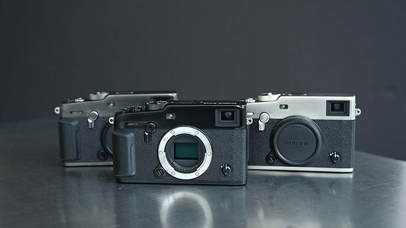 The standard titanium black X-Pro3 is in front, while the two Duratect finishes are in the rear.