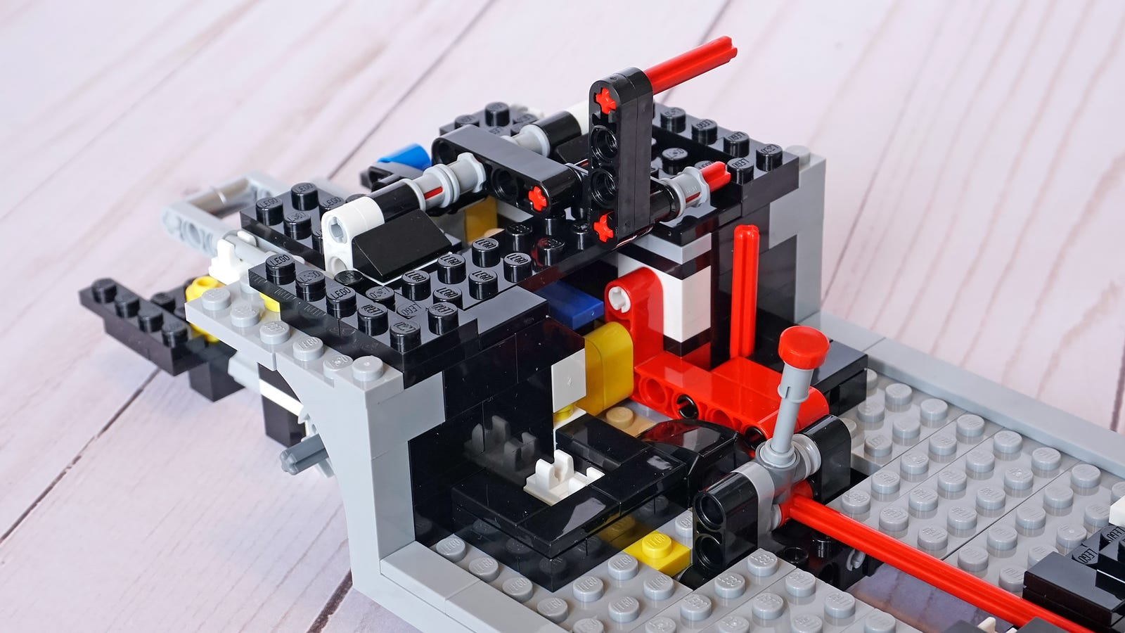 The hidden mechanisms powered by Lego Technic components add a lot of novelty to the model and the build process.