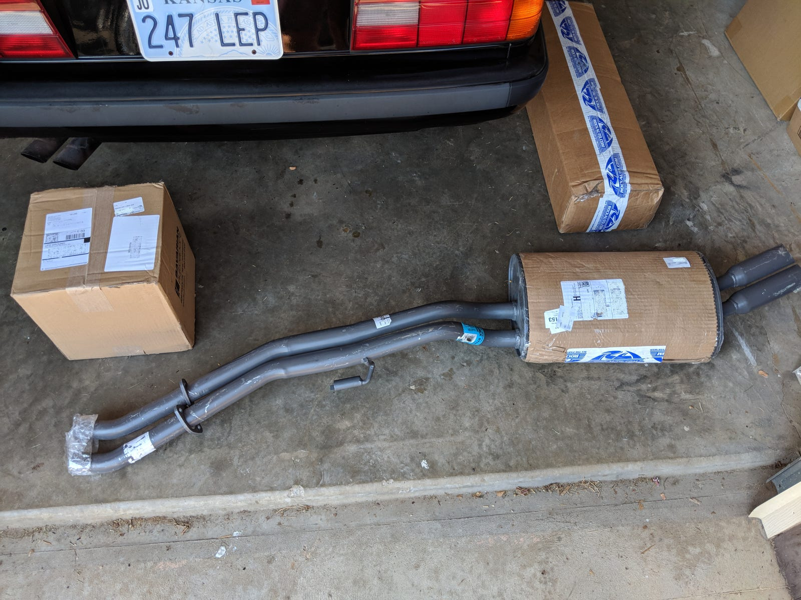 A new muffler! The minimalist packaging welcomed a dent to occur during shipping. Oh well, it's under the car anyway.