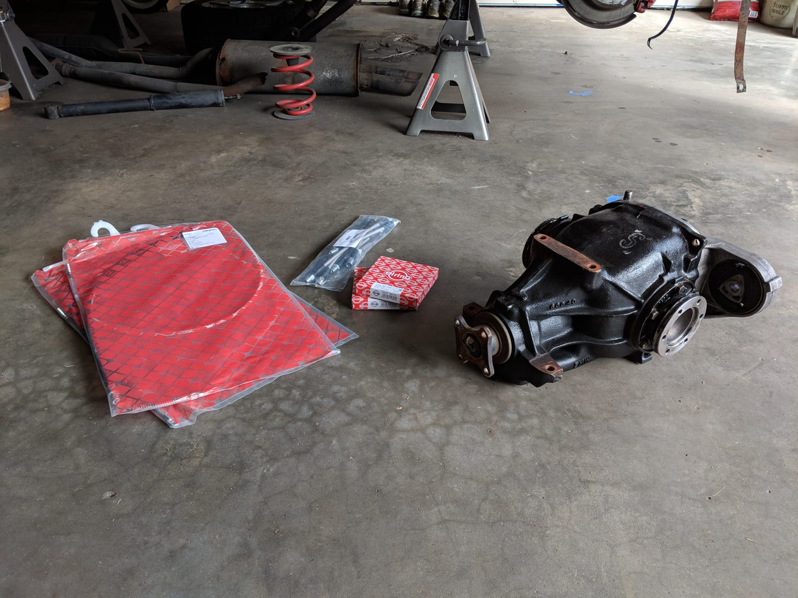 Limited-slip differential preparing to accept new output flange seals (center).