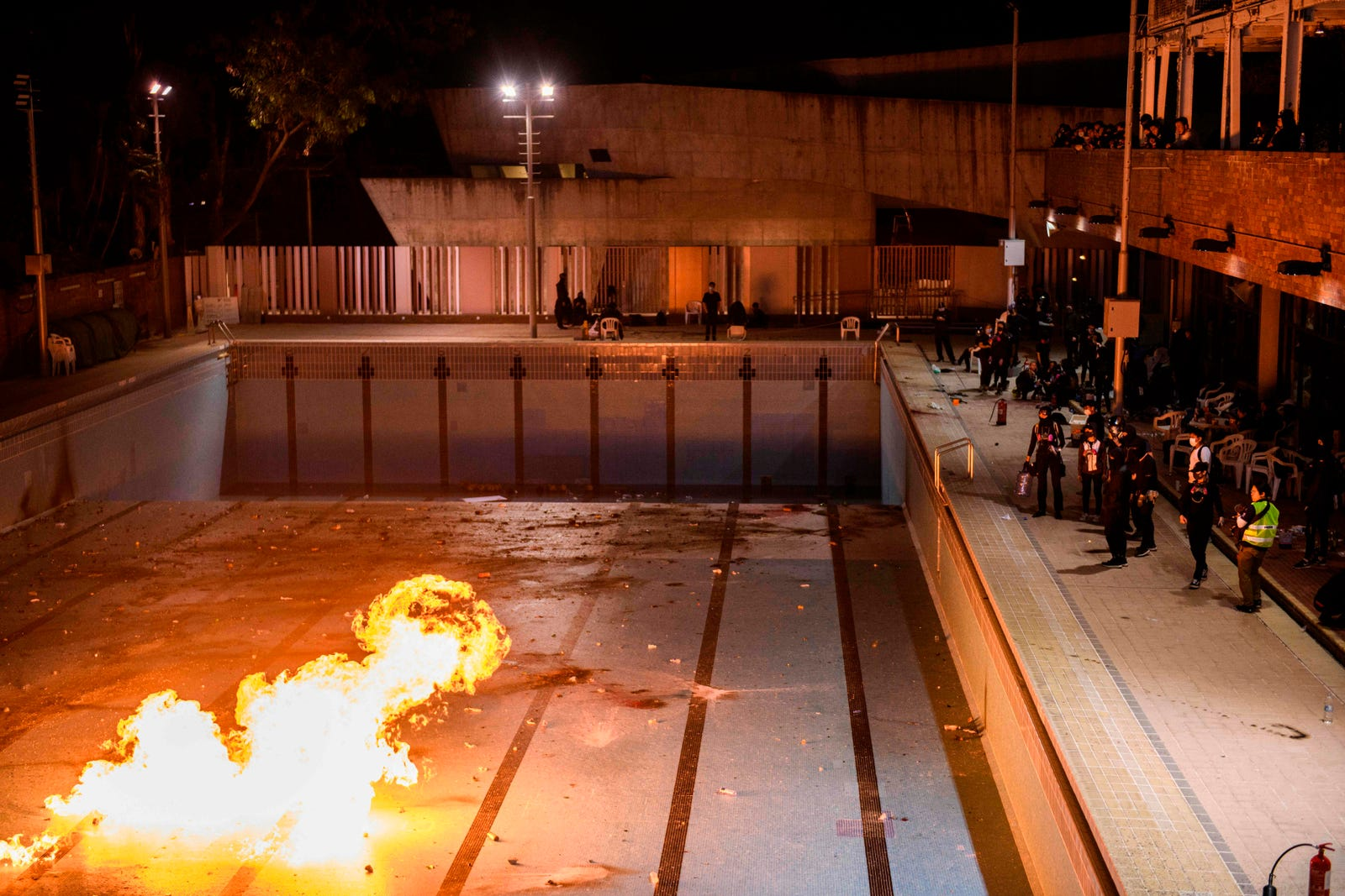 In this picture taken on November 14, 2019, protesters practice throwing molotov cocktails into an emptied 50-meter Olympic-size swimming pool at the Hong Kong Polytechnic University in Hung Hom, Hong Kong.