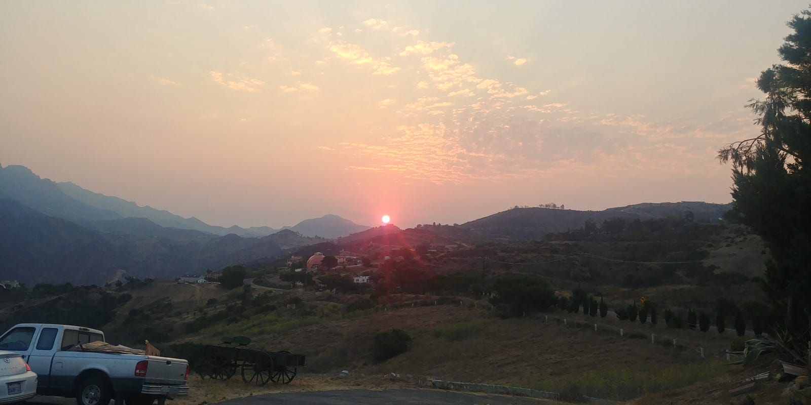 """""""Sunrise at home on a hazy morning due to smoke from the many California Forest fires going on up north."""""""