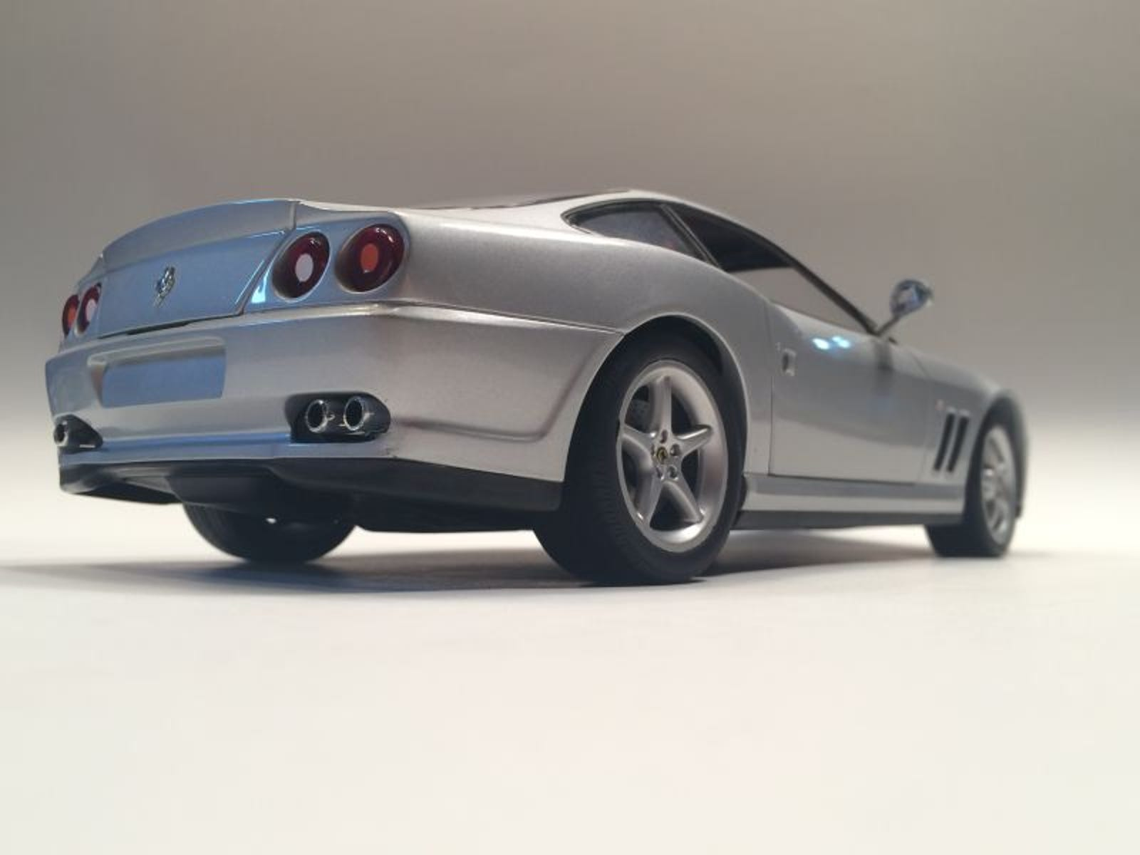 Lot 28: Repaired 1:18 scale UT Ferrari 550 $5 - Maisto front wheels, you pay shipping. More details below.