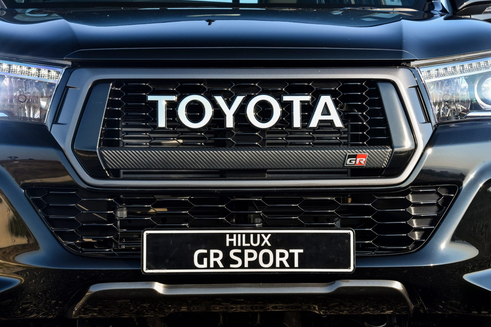 Illustration for article titled The Giant Emblem Grille on the Toyota Hilux GR Sport Is Just the Best