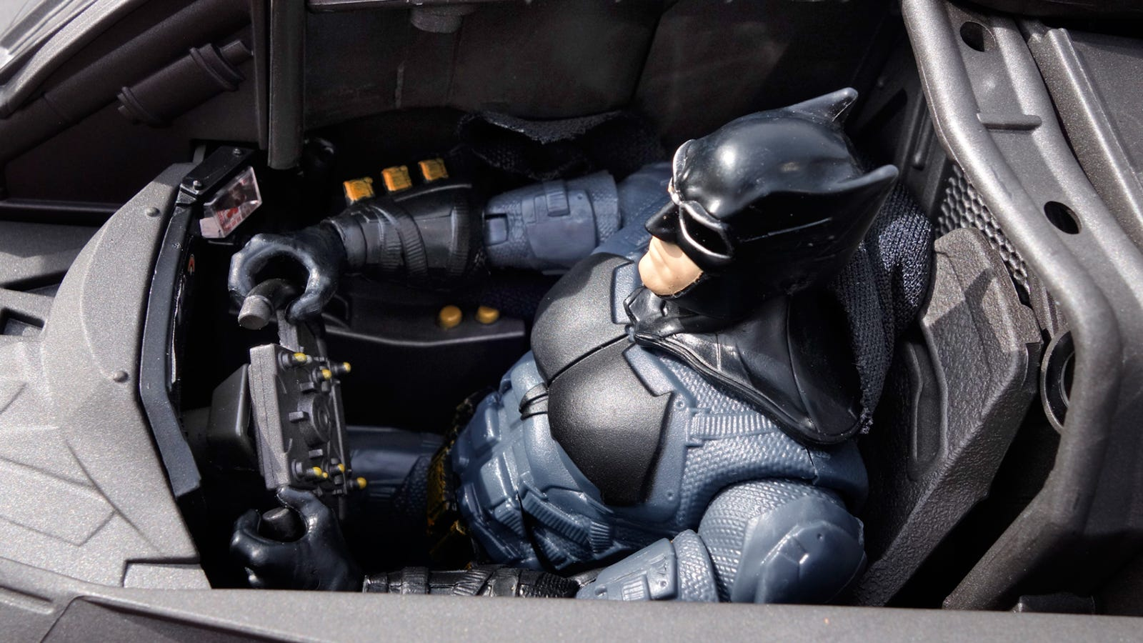 The cockpit's dashboard glows, and the steering wheel matches the movements of the Batmobile's front tires.