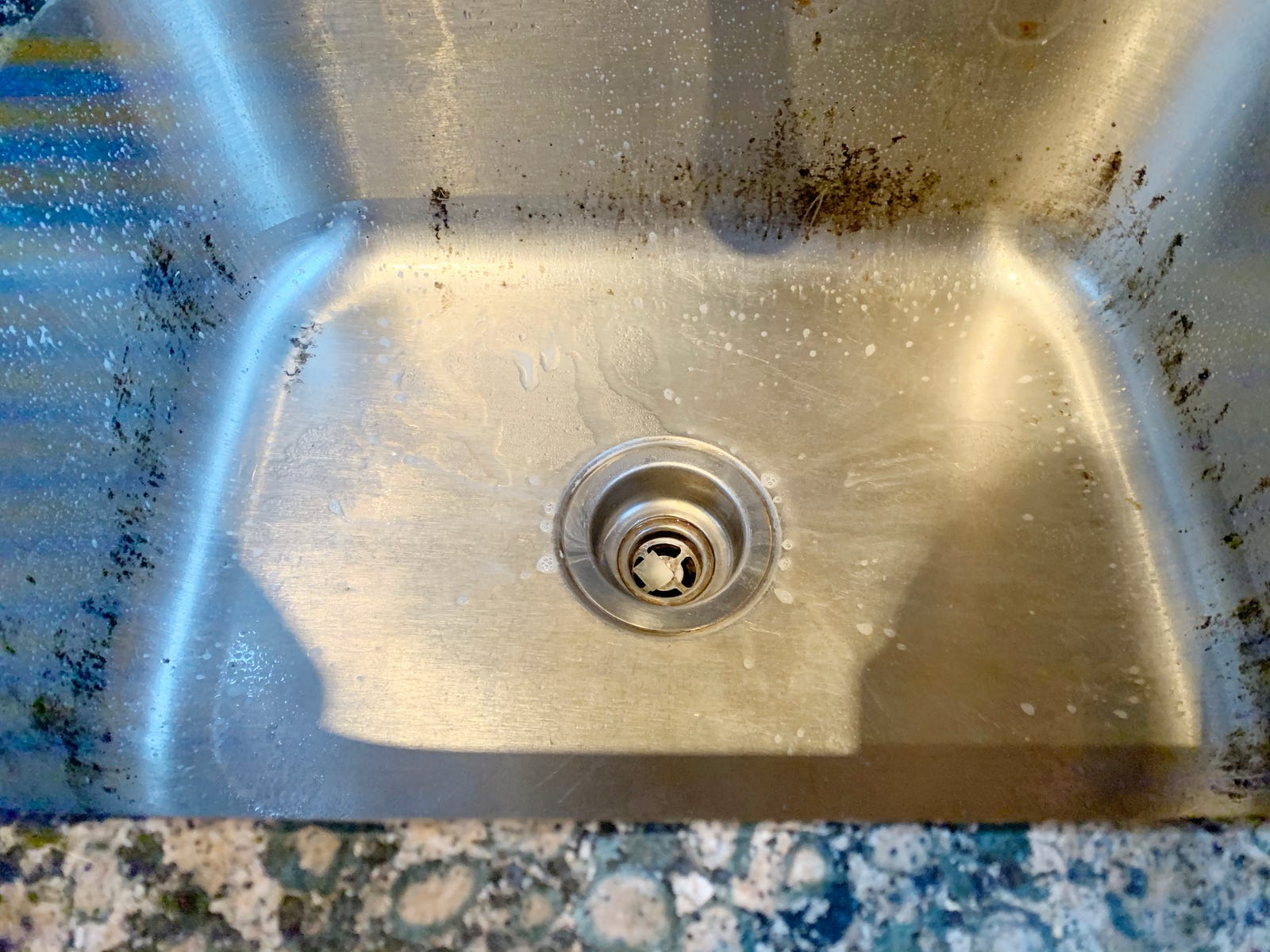 The sink before the drill brush.