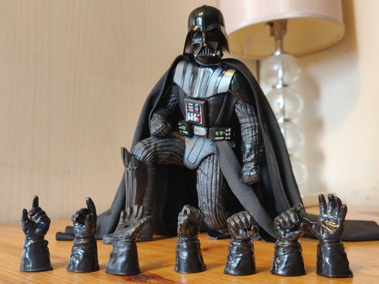Vader mainly comes with a giant array of swappable hands. Other than that, he has a stand, his lightsaber (with detachable blade), and a Force FX piece to replicate him blocking blaster bolts like he does on Bespin in Empire Strikes Back.