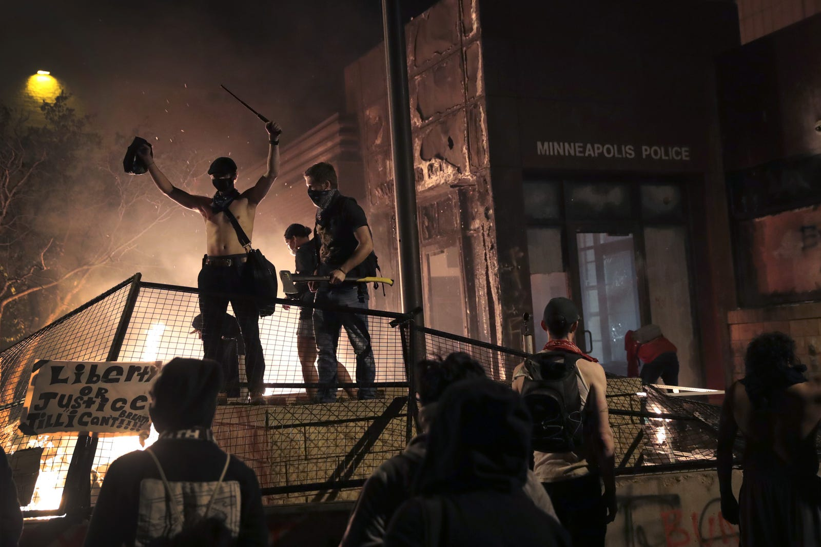 Protesters gather in front of the 3rd precinct police building while it burns on May 28, 2020 in Minneapolis, Minnesota.