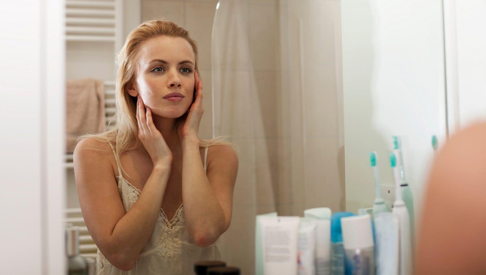 Woman Bids Farewell To Former Self Before Beginning New Skin Care Regimen