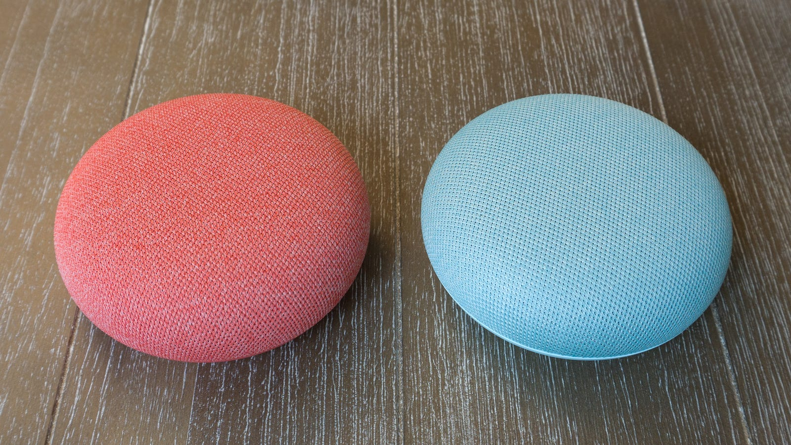 The Google Nest Mini on the left, compared to the Google Home Mini on the right. Can you tell them apart? We can't.