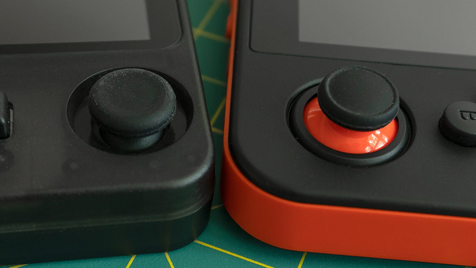 The recessed analog joystick on the RK2020 (left) makes the handheld easier to pocket, and it has less travel and is slightly looser than the joysticks on the RG350 (right), which I prefer. However, you only get one.