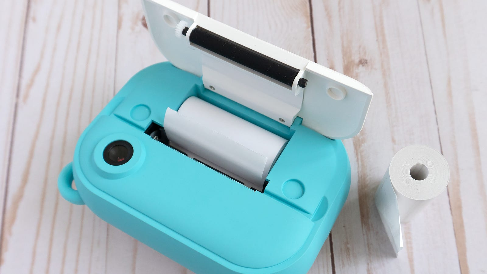 Installing a roll of thermal paper couldn't be easier: You just open a door on the front of the camera, drop the roll in, and then ensure the end sticks out of a thin slot when you close the camera up again.
