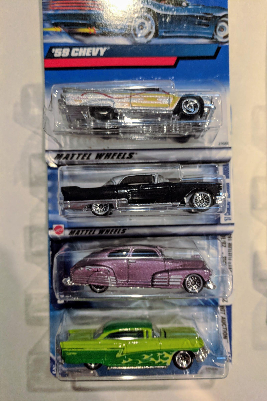 Lot 8: Americana - $20 for 23 cars - includes '59 Chevy, '57 Cadillac, Chevy Fleetline, a Mercury...