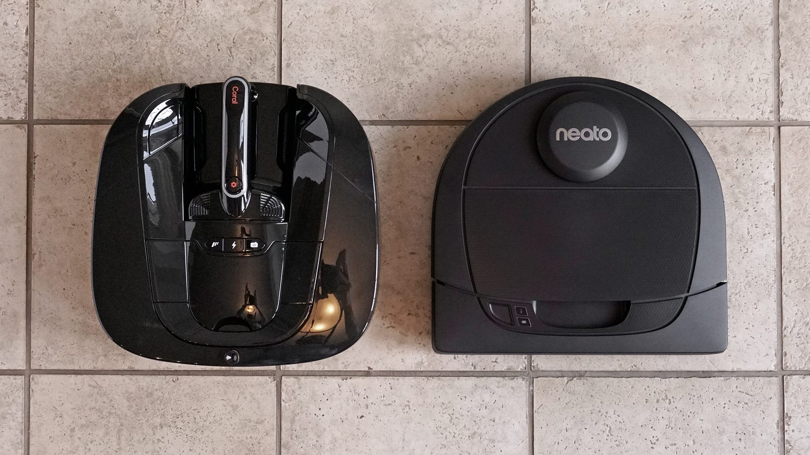 The Coral One (left) has roughly the same footprint as the Neato D4 (right).