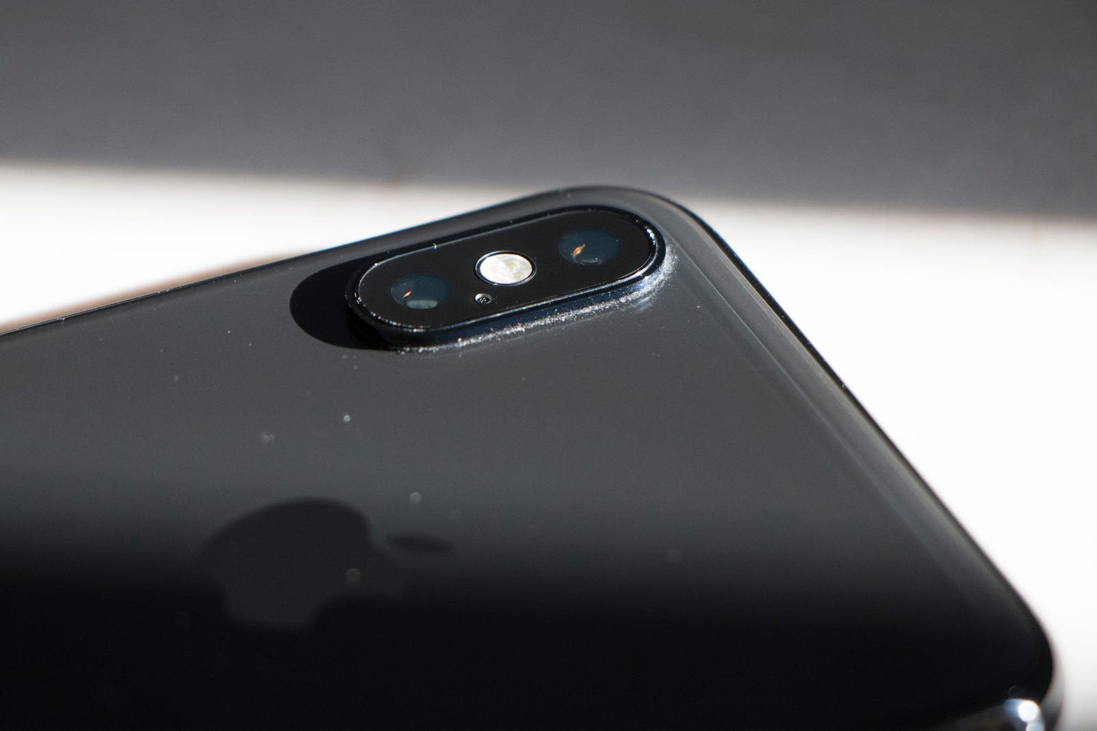 The phone's dual-lens camera is still in perfect condition.