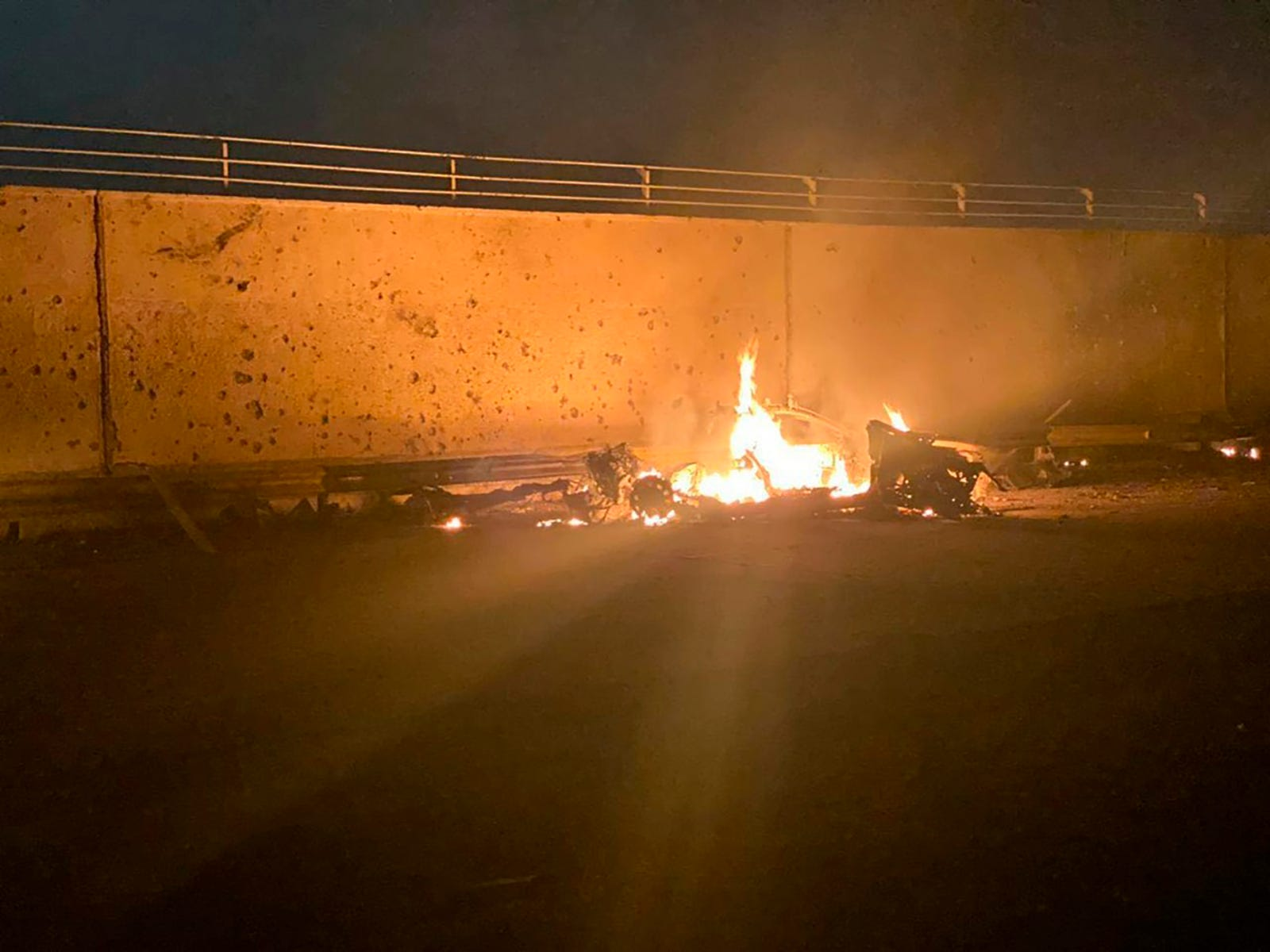 This photo released by the Iraqi Prime Minister Press Office shows a burning vehicle at the Baghdad International Airport following an airstrike, in Baghdad, Iraq, early Friday, Jan. 3, 2020.