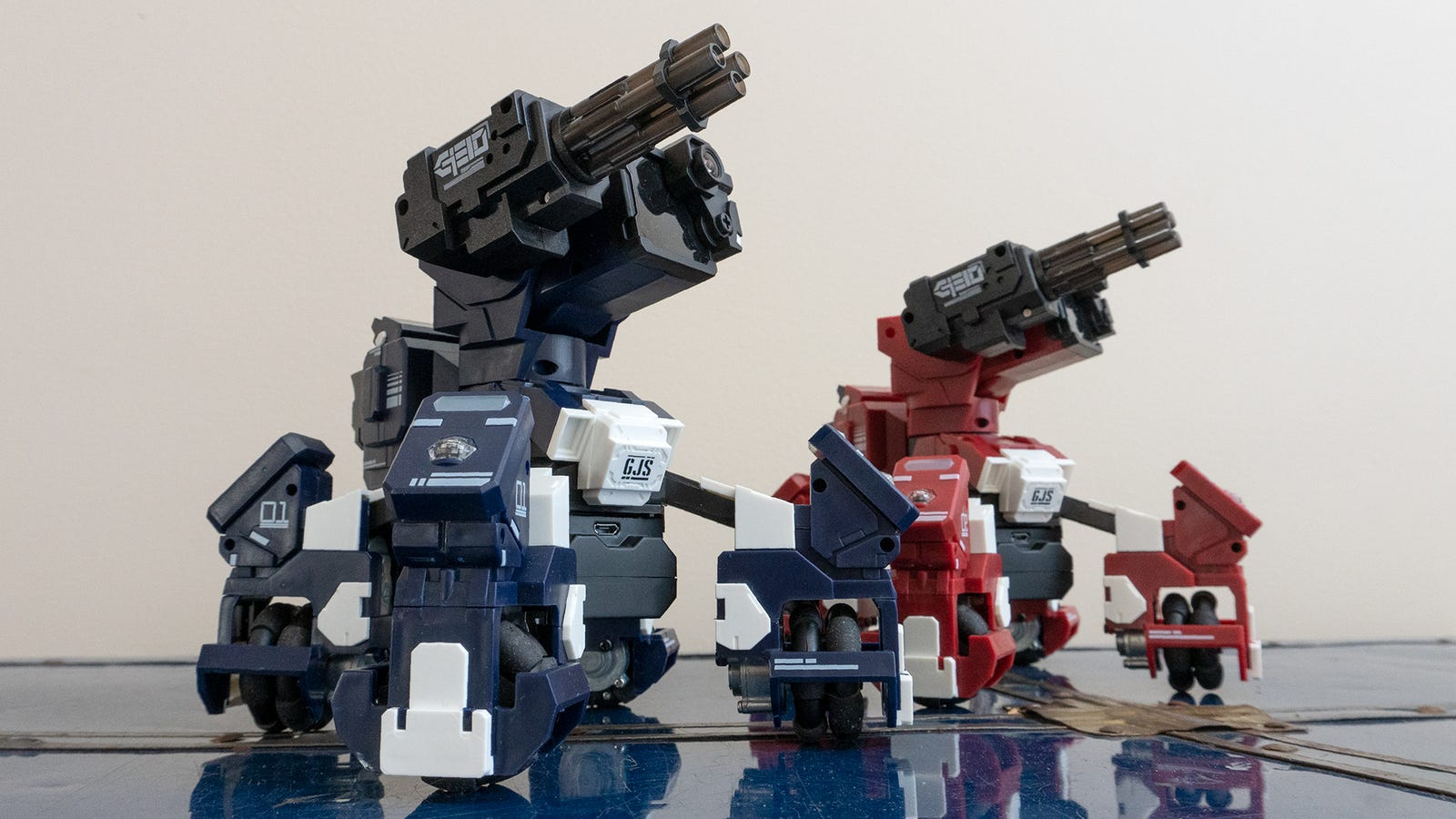 There are currently two versions of the Geio robot, distinguished by a red or blue color scheme.