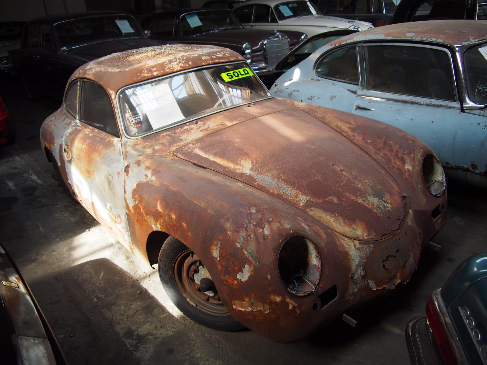 A 356A that has become a magnificent husk of rust. I hope the new owner preserves that patina.