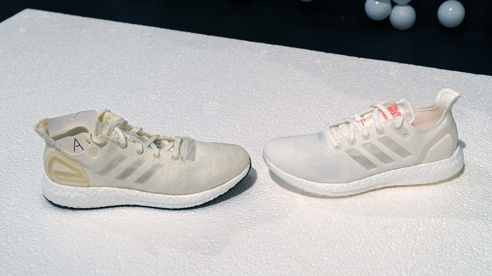 Here's a shot of an early Loop prototype next to a more final version. Side-by-side, you can see how much more precise Adidas' TPU manufacturing got.