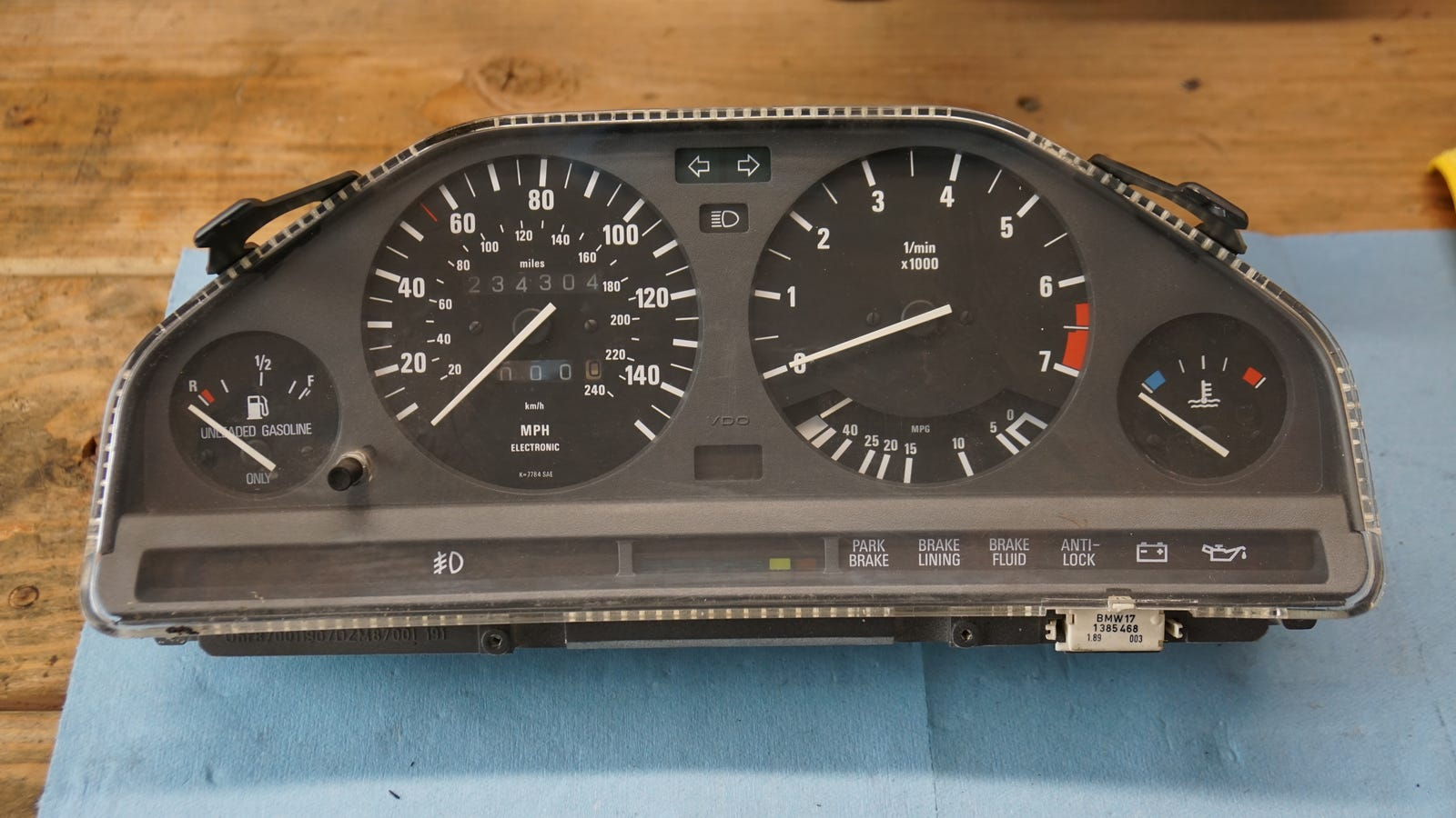 Instrument cluster placed on the work bench in a futile attempt to revive it.