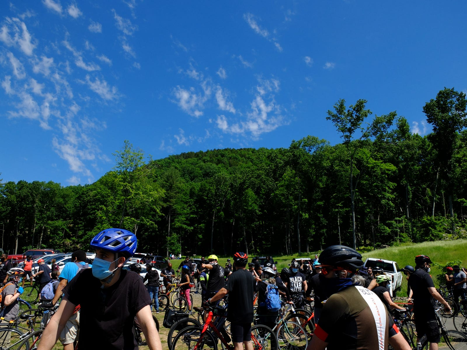 I shot this at the starting point Hamden/New Haven's first Black Lives Matter support ride, Sleeping Giant State Park, 6/13/2020. About 300 riders. Fujfilm X20, f/4at 1/1250 sec, lens set to 7.6mm (about ~30mm, in 35mm equivalent). Fujifilm Velvia emulation.