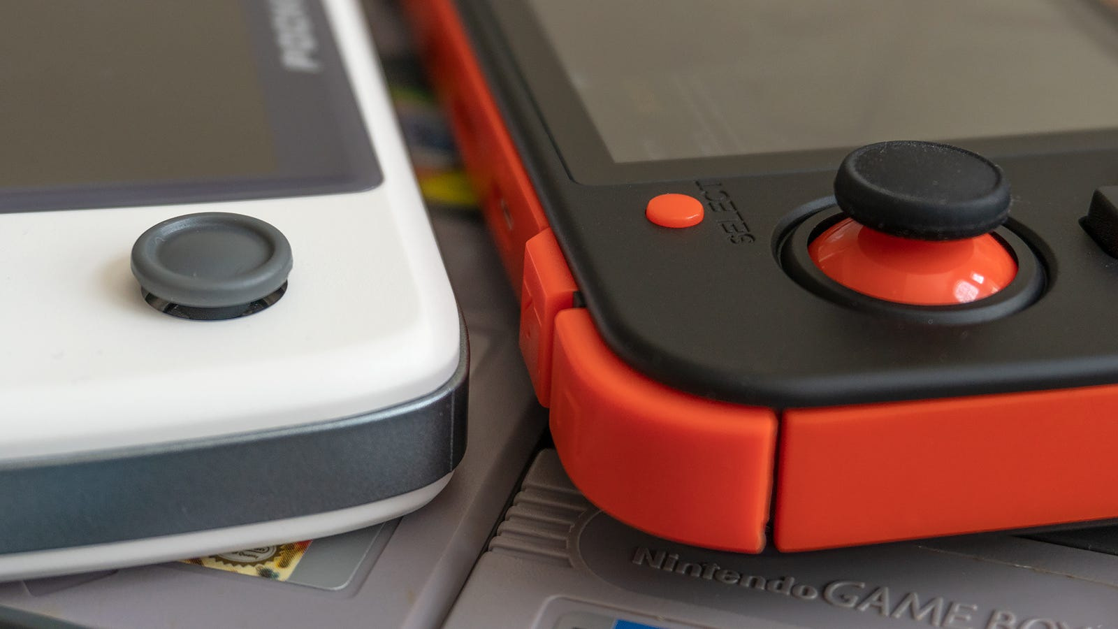 The New Pocket Go's analog joystick (left) was all but unusable, but the RG350's (right) are almost perfect.