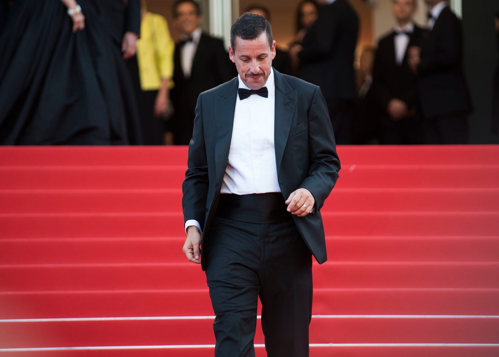 "Sandler at Cannes in France looking his absolute best–with his hair combed down, and high-waisted pants. Is this what people mean when they say ""zaddy""?"