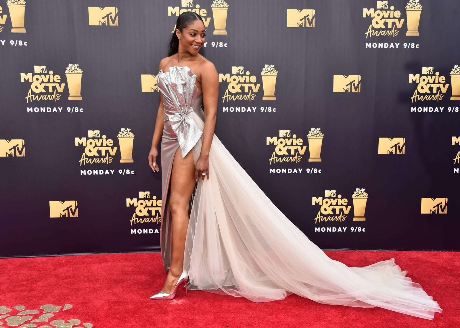 She ready: Haddish hits the red carpet looking stunning in silver.
