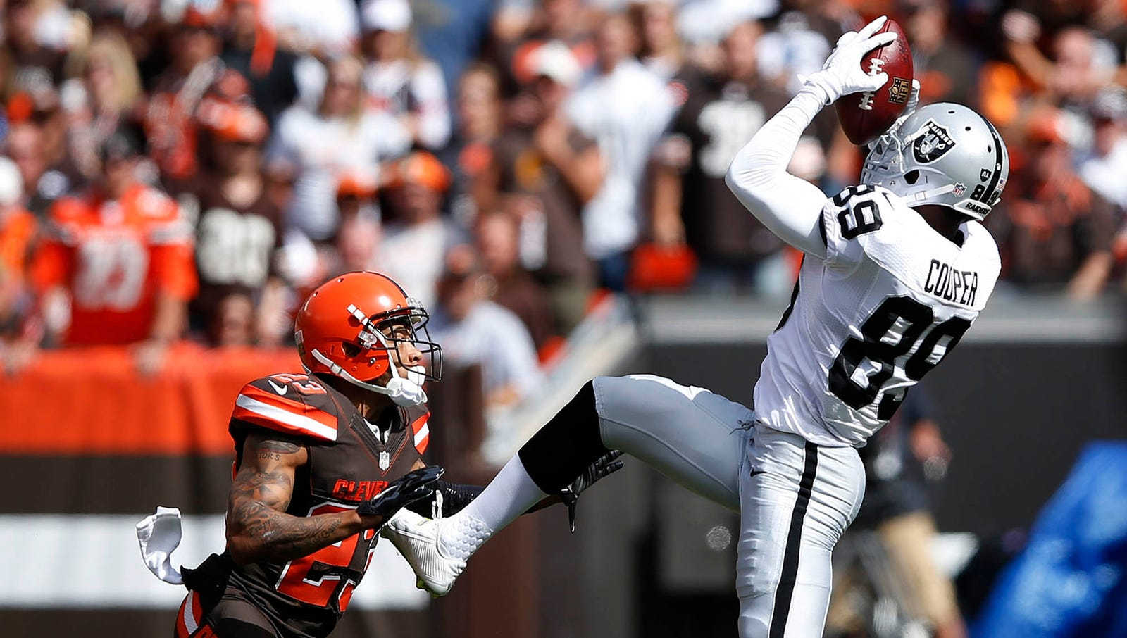 """""""The Catch"""": With 2:58 left in the first quarter of a week 3 game against the Cleveland Browns, Oakland Raiders quarterback Derek Carr successfully connected with rookie wide receiver Amari Cooper for a 9-yard gain, turning second-and-15 into a manageable third-and-6."""