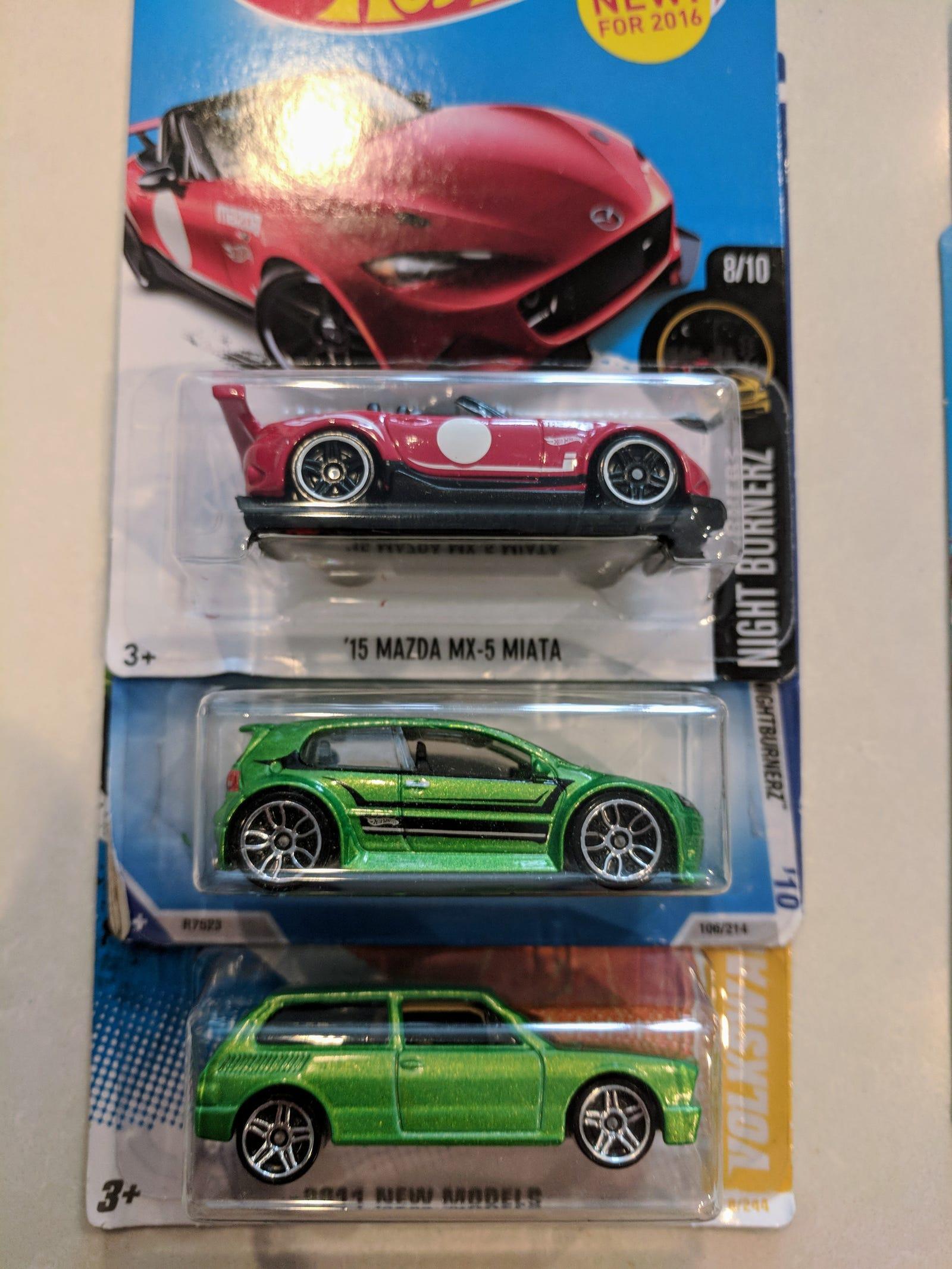 Lot 24: Fan Boi collection - $5 for 8 cars including a ND Miata, Mk6 GTI, VW Brasilia...