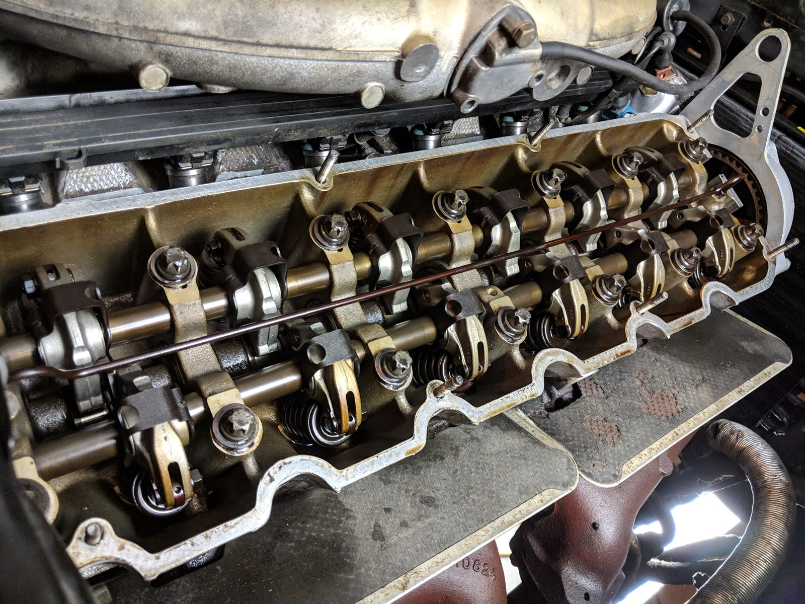 Valves adjusted. That's looking clean for an engine with over 230,000 miles on it.
