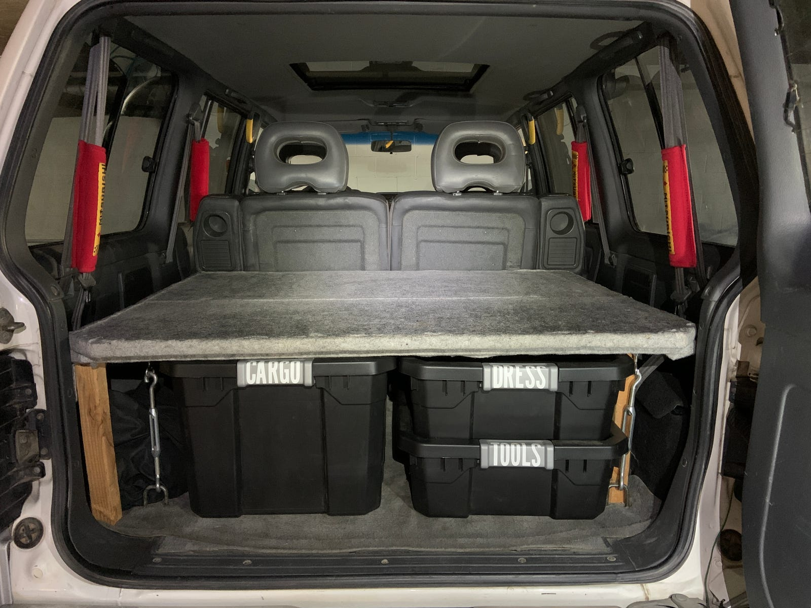 Daily driver mode: Tools and cargo are hidden from view outside, but there's still a shelf for more luggage