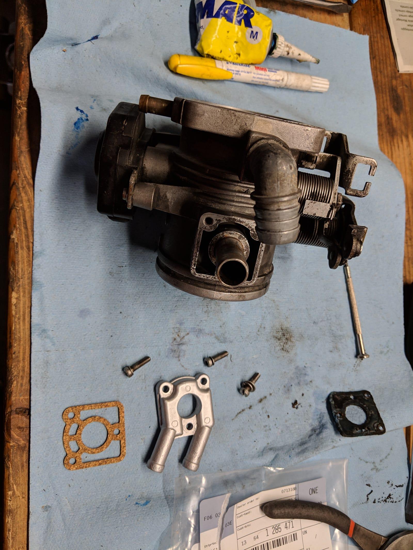 New cork throttle body heater gasket ready to go in.