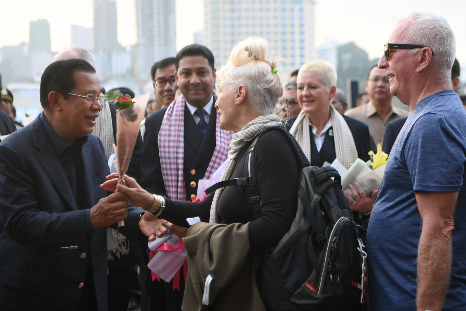 Cambodia's Prime Minister Hun Sen (left) meets passengers who disembarked from the Westerdam cruise ship in Sihanoukville on February 14, 2020.