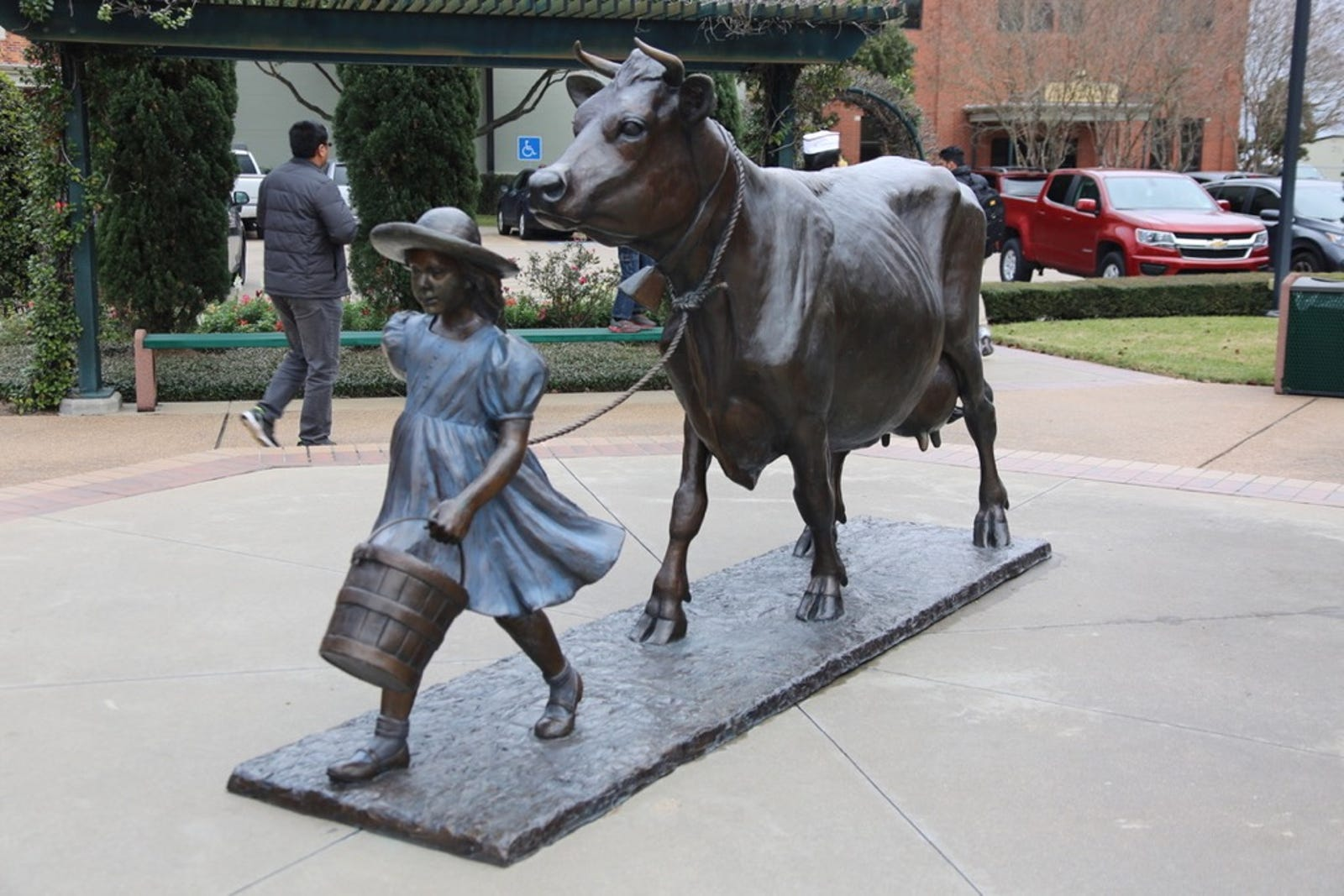 The Blue Bell Girl with her cow
