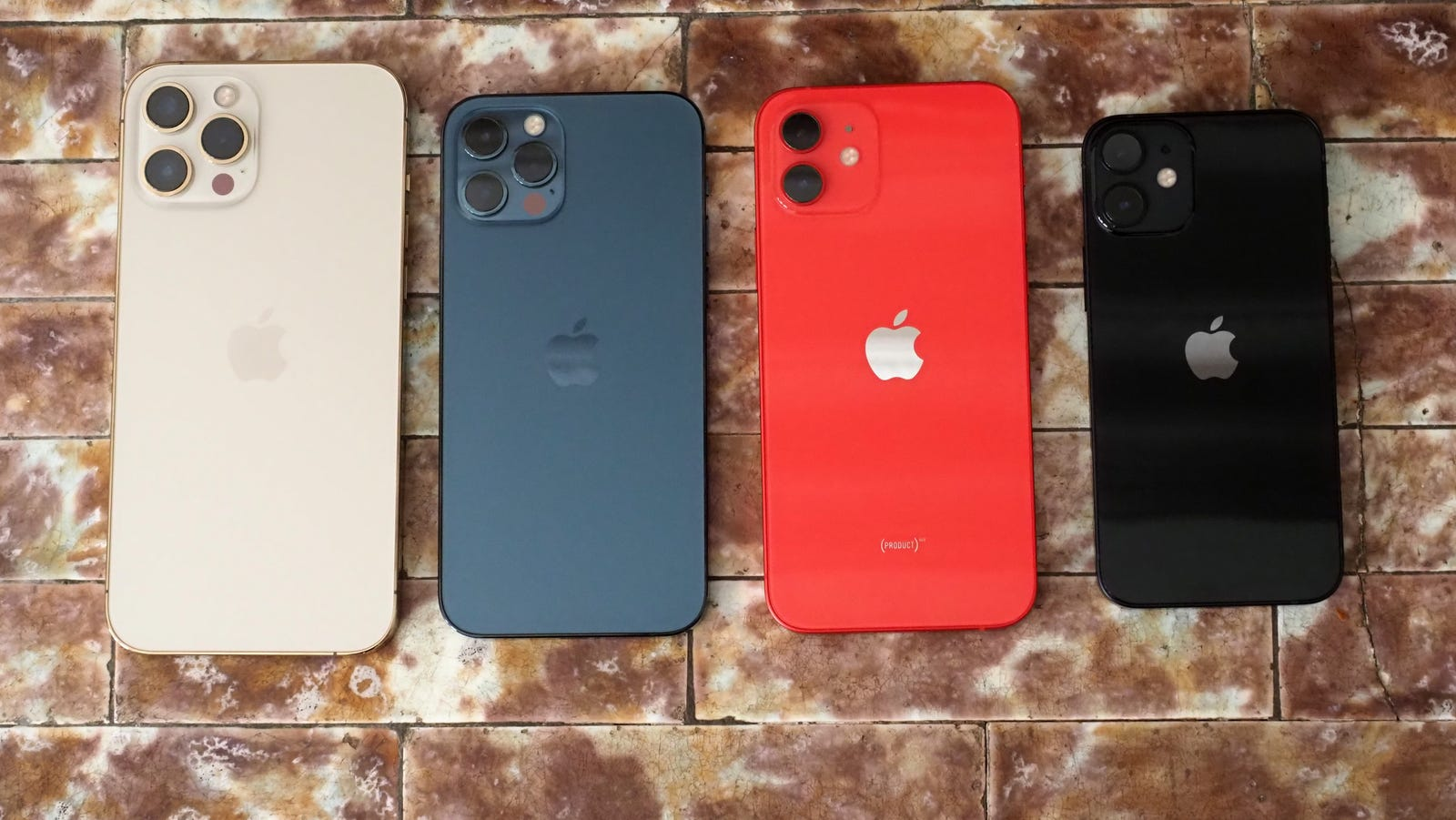 From left to right: iPhone 12 Pro Max, iPhone 12 Pro, iPhone 12, iPhone 12 Mini